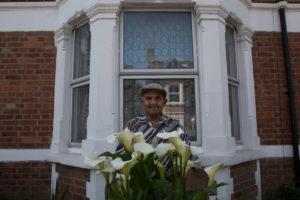 Portrait of man at bay window