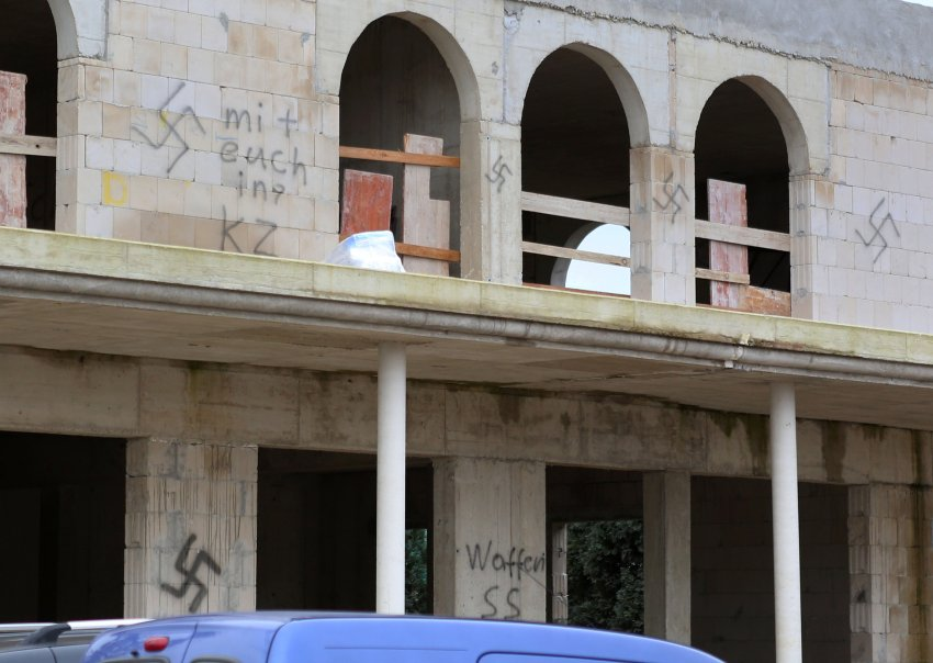 In Germany, graffiti and arson damage mosques and refugee camps