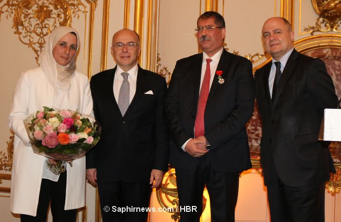 Bernard Cazeneuve presents Legion of Honor to the Head of the Conseil Francais du Culte Musulman, Anouar Kbibech