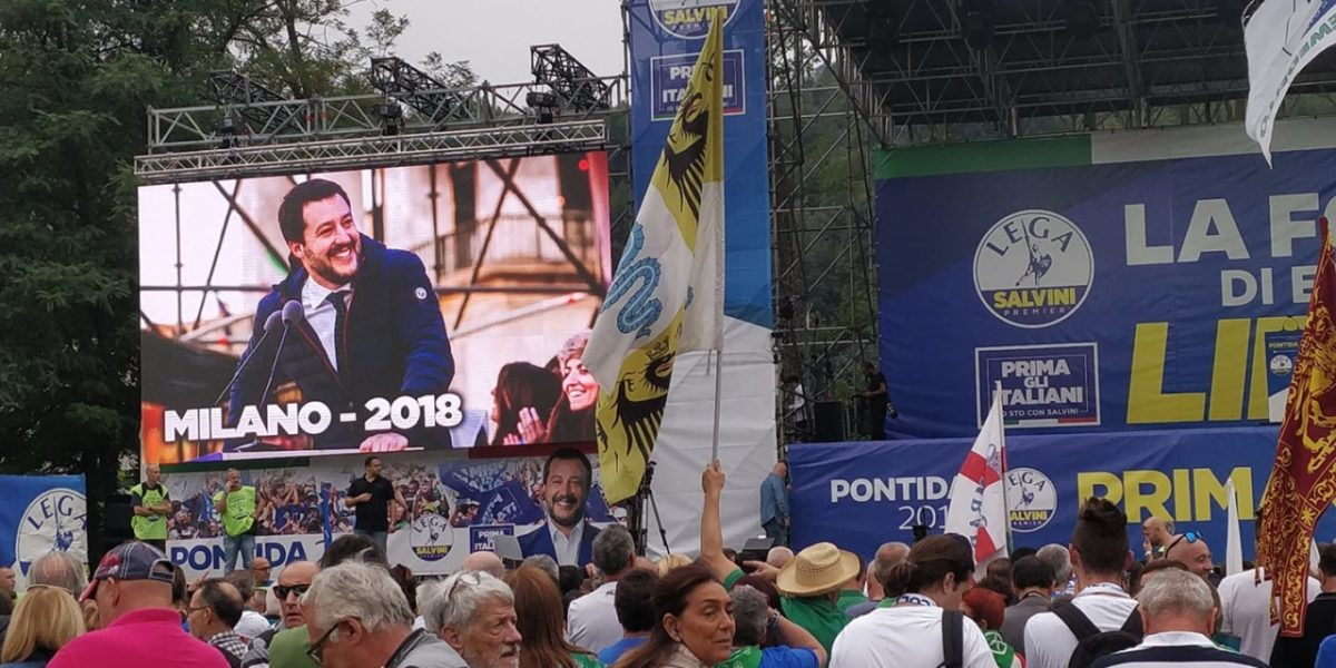League rally in Pontida, Matteo Salvini appears on a big screen to the left hand side of the image Italy, September 2019