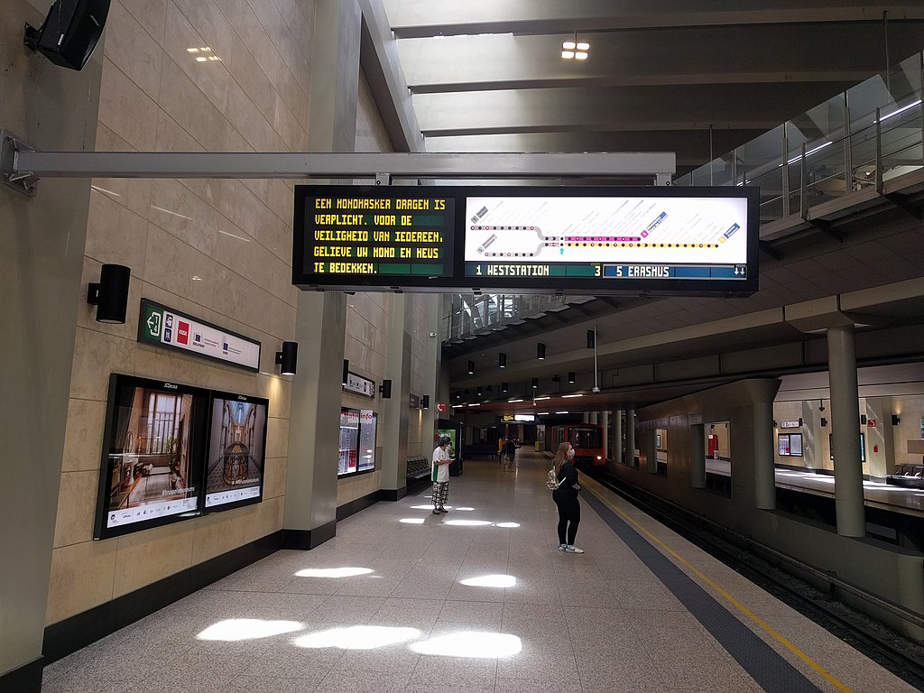 Schuman Metro station in Brussels, during the COVID-19 pandemic, with a board telling the security measures.