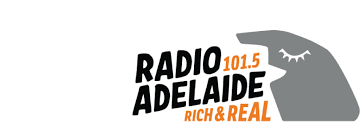 Branding for The Focus current affairs radio show on Radio Adelaide in Australia. Consists of the shows name in slightly serified block capitals in tangerine orange and black, next to a cartoon, faintly cubist style rendering of a head with an open mouth speaking which is in grey